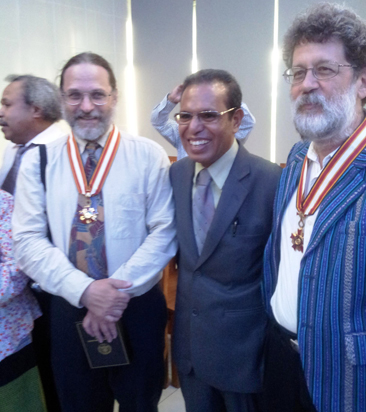 John M. iller, President Taur Matan Ruak and Charles Scheiner at awards cermony